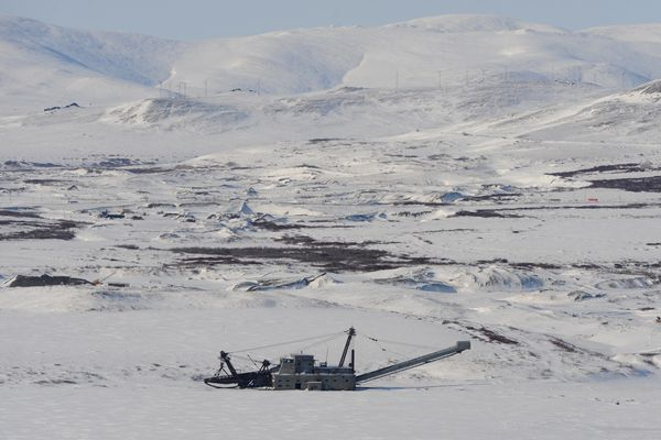 Aerial view of a historic gold dredge sitting idle on the frozen landscape near Nome, Alaska. (Bill Roth / ADN archive 2013)