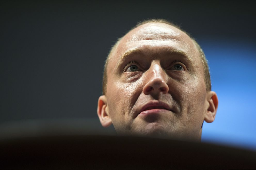 FILE - In this July 8, 2016 file photo, Carter Page, an adviser to U.S. Republican presidential candidate Donald Trump, speaks at the graduation ceremony for the New Economic School in Moscow, Russia. (AP Photo/Pavel Golovkin)