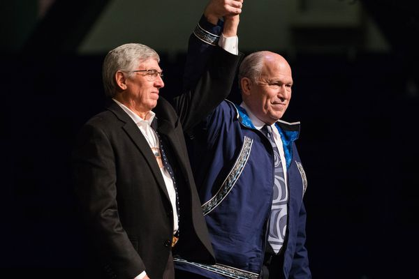 Alaska Governor Bill Walker, right, takes the stage with Lt. Governor Byron Mallott on the first day of the Alaska Federation of Natives convention at the Carlson Center in Fairbanks on Thursday, Oct. 20, 2016. (Loren Holmes / Alaska Dispatch News)