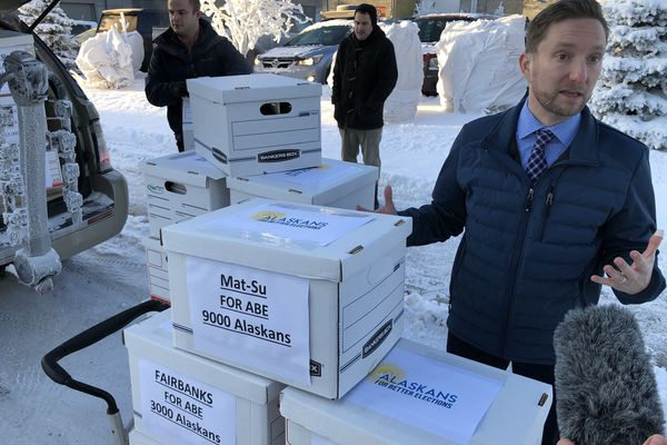 Former state Rep. Jason Grenn, co-chair of Alaskans for Better Elections, turns in 41,068 signatures as part of a ballot measure campaign Jan. 9, 2019 at the Alaska Division of Elections. (James Brooks/ADN)