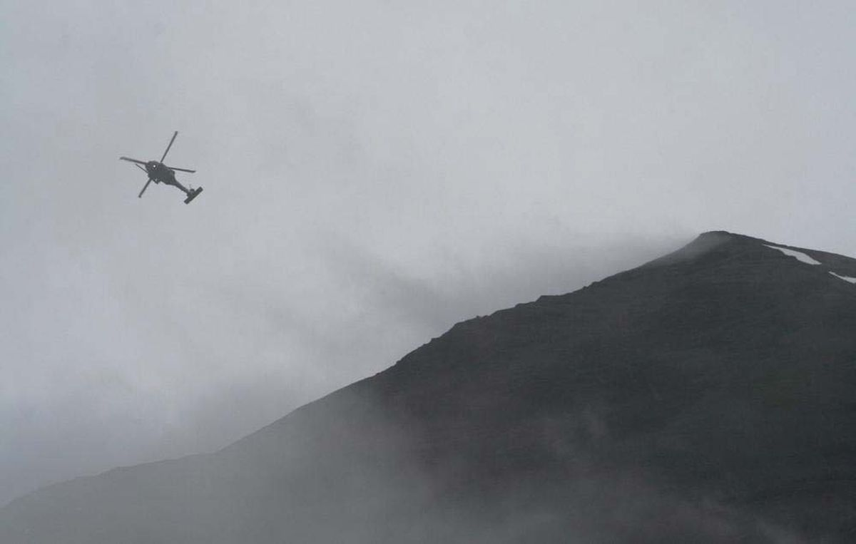 An Alaska Air National Guard Pave Hawk helicopter participates in the search Thursday, July 5, 2012, for Michael LeMaitre on Mount Marathon. (Photo by Luke Rosier)