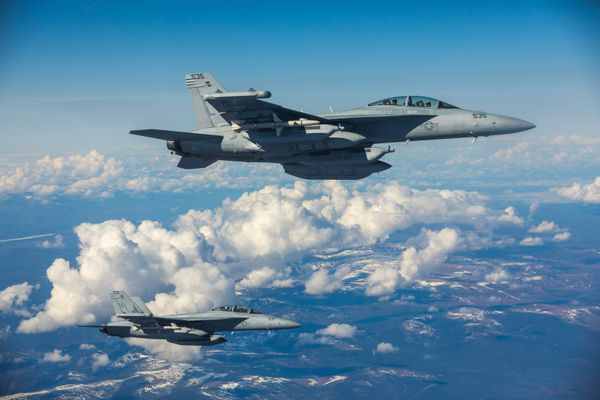 A pair of Navy EA-18G Growlers from Whidbey Island Naval Air Station, Washington fly off the wing of a KC-10A Extender from Travis Air Force Base Thursday, May 11, 2017 during Northern Edge exercises over interior Alaska. The KC-10A Extender can carry 350,000 pounds of fuel and can refuel aircraft from any coalition force. (Loren Holmes / Alaska Dispatch News)