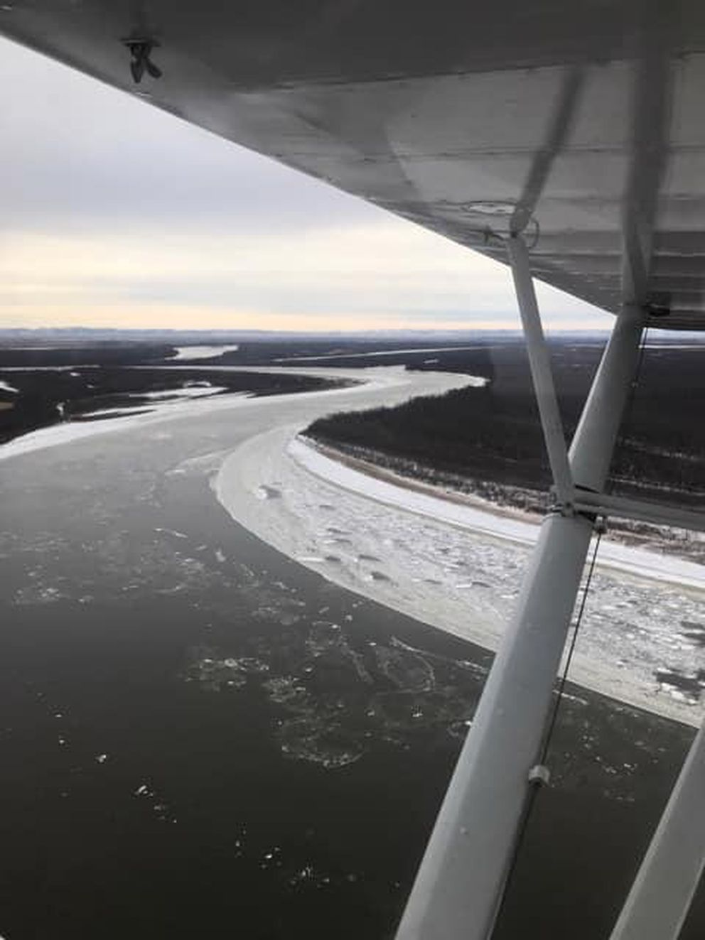 FILE - An aerial survey by U.S. Fish and Wildlife Service shows open water on the Kuskokwim River on November 15, 2018. (U.S. Fish and Wildlife Service photo)