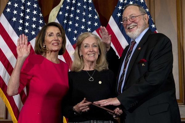 FILE - In this Jan. 3, 2019, file photo, House Speaker Nancy Pelosi of Calif., left, administers the House oath of office to Rep. Don Young, R-Alaska, with his wife, Anne Garland Walton, middle, during ceremonial swearing-in on Capitol Hill in Washington during the opening session of the 116th Congress. U.S. Rep. Don Young was feted for becoming the longest-serving Republican in House history. Young, who was re-elected in November, marked 46 years in the House Wednesday, March 6. He surpasses the late former Speaker Joseph Cannon to become the longest-serving Republican. House Speaker Nancy Pelosi thanked Young for being