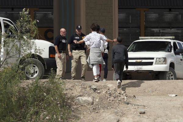 FILE - In this July 4, 2019 file photo, a group of asylum seekers cross the border between El Paso, Texas, and Juarez, Chihuahua, Mexico, Thursday, July 4, 2019. (Mark Lambie/The El Paso Times via AP)