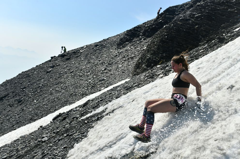 Courtney Lyons of Anchorage slides down a patch of snow. (Marc Lester / ADN)