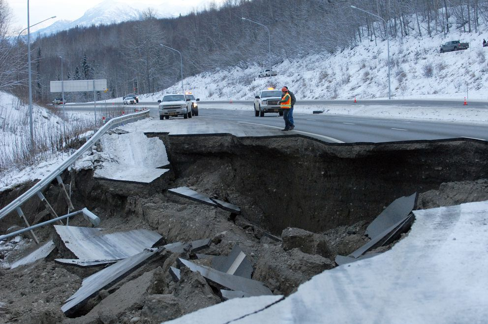 A section of the Glenn Highway damaged by Friday's earthquake. The road fell away between Eklutna and Mirror Lake. A Department of Transportation project manager said the damage will take several days to repair, but didn't have an exact timeline. (Matt Tunseth / ADN)