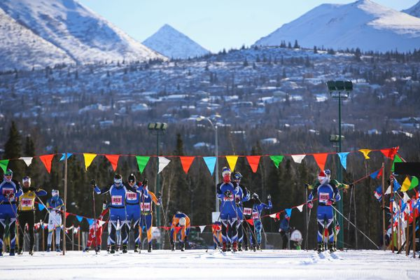 The first group of racers prepare to leave the starting line at Service High School during the 33rd annual Tour of Anchorage on March 7, 2021. Due to COVID-19 restrictions, the start was modified to 10 racers leaving every two minutes to allow for social distancing. (Emily Mesner / ADN)