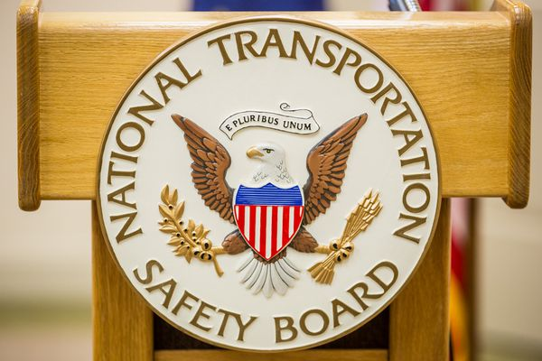 The National Transportation Safety Board emblem is seen on a podium in this file photo taken on July 9, 2013. (Loren Holmes / ADN archive)