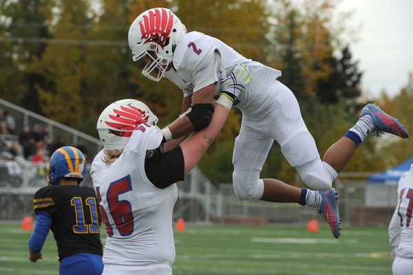 Noah Johnson, of East High, hoists Sio Sefo in the air after Sefo scored a two-point conversion after a touchdown during a Bartlett high homecoming football game in Anchorage, Alaska on Saturday, Sept. 16, 2017. East high won 27-20 over Bartlett High. (Bob Hallinen / Alaska Dispatch News)
