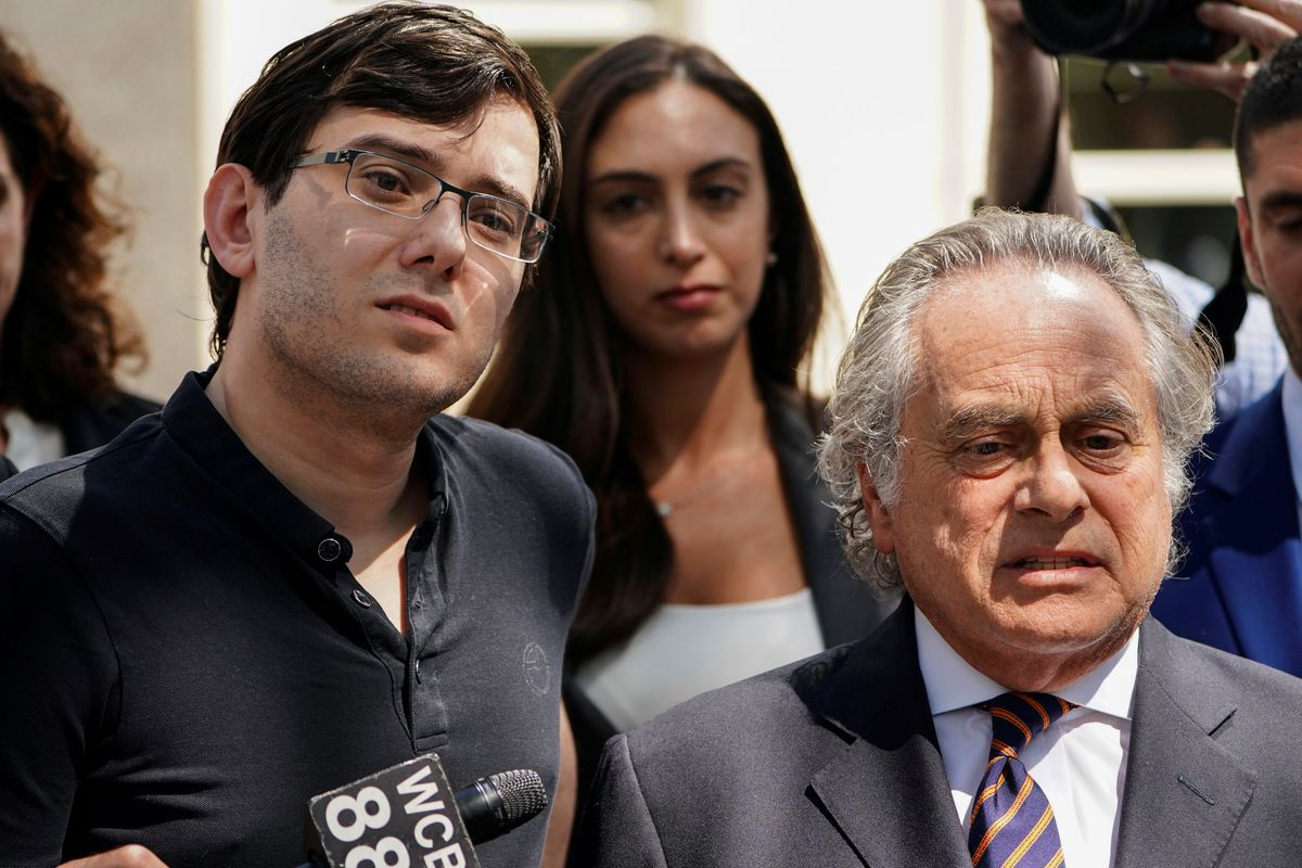 Former drug company executive Martin Shkreli stands with his attorney Benjamin Brafman after exiting U.S. District Court upon being convicted of securities fraud, in the Brooklyn borough of New York City, U.S. on August 4, 2017. REUTERS/Carlo Allegri/File Photo
