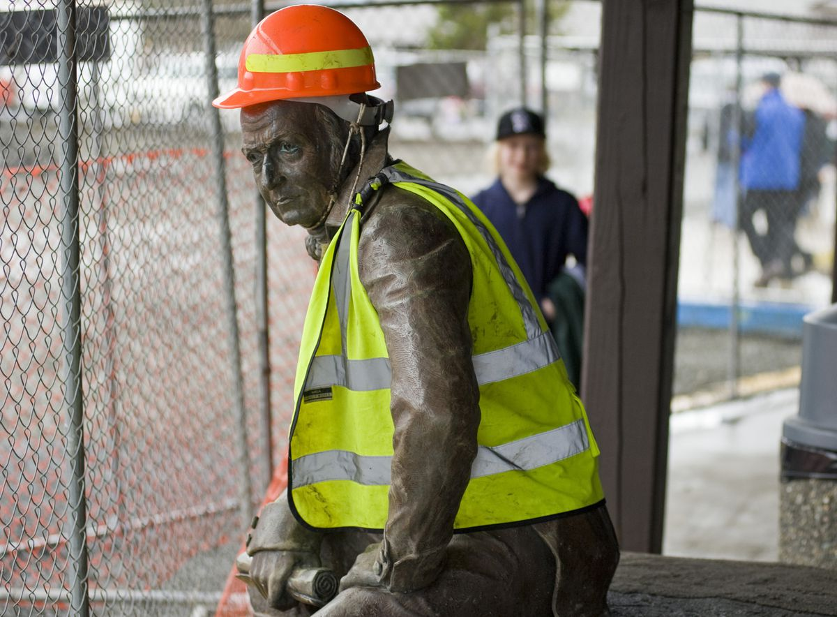 FILE - In this file photo taken Feb. 1, 2013, the bronze statue of 19th century Russian America Governor Alexander Baranov sports a hard hat and a reflective vest, after being moved from its original site in front of Centennial Hall in Sitka (James Poulson/Daily Sitka Sentinel via AP, File)