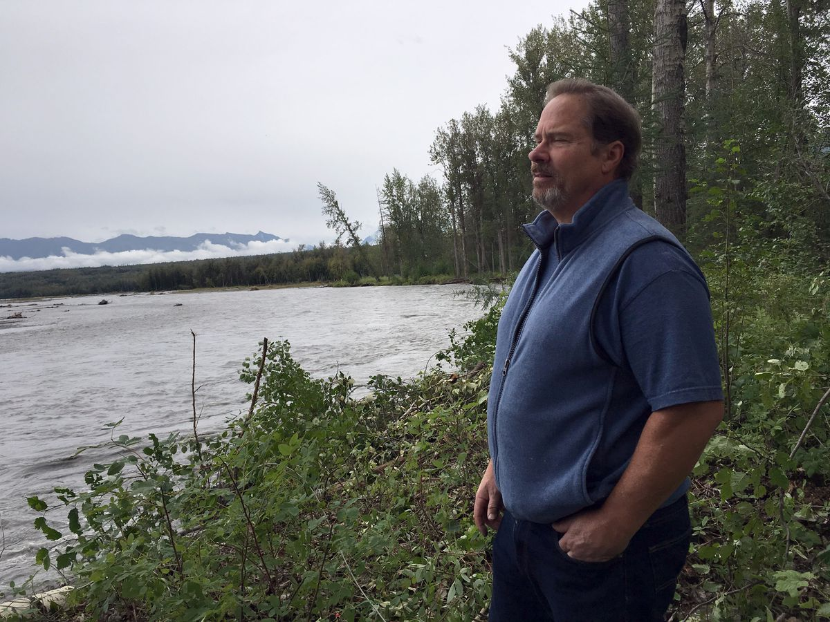 Scott Easler, a homeowner along the Matanuska River, stands onits banks Thursday amid growing concern erosion could send water coursing over nearby properties and the Old Glenn Highway. (Zaz Hollander / Alaska Dispatch News)