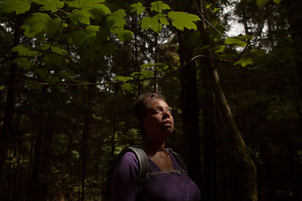 Shamay Thomas, an avid hiker, pauses at Washington state's Point Defiance Park in late August. (Jovelle Tamayo for The Washington Post)