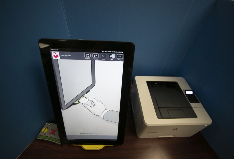 A Dominion Voting Systems voting machine is seen in Atlanta. (AP Photo/John Bazemore, File)