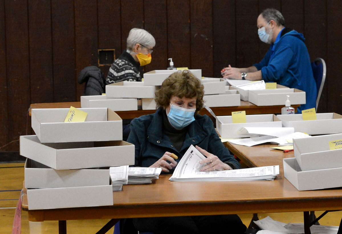 Election workers hand-count ballots from Alaska's 2020 general election on Wednesday, Nov. 18, 2020 in Juneau, Alaska. (James Brooks / ADN)