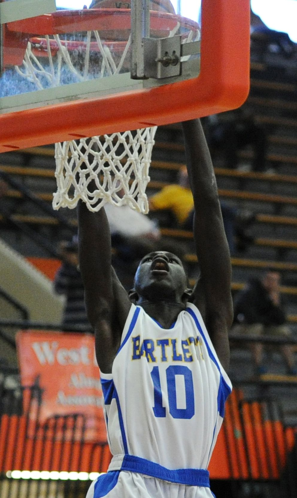 Bentiu Panoam dunks the ball during Bartlett's 71-45 victory over the Service Cougars in the 2016 Cook Inlet Conference championships.