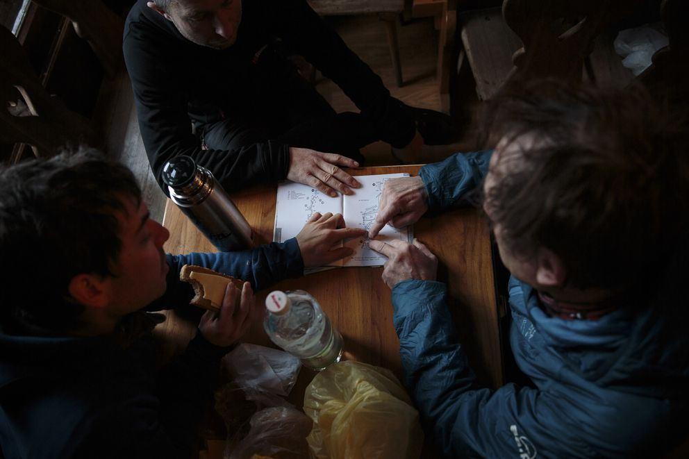From left: Kacper Tekieli, Piotr Tomala and Janusz Golab plot a route for a day of climbing in the Tatra Mountains of southern Poland, Jan. 10, 2017. They are among a group planning what would be a first-ever winter ascent of K2, the notorious Himalayan peak. (Max Whittaker/The New York Times)