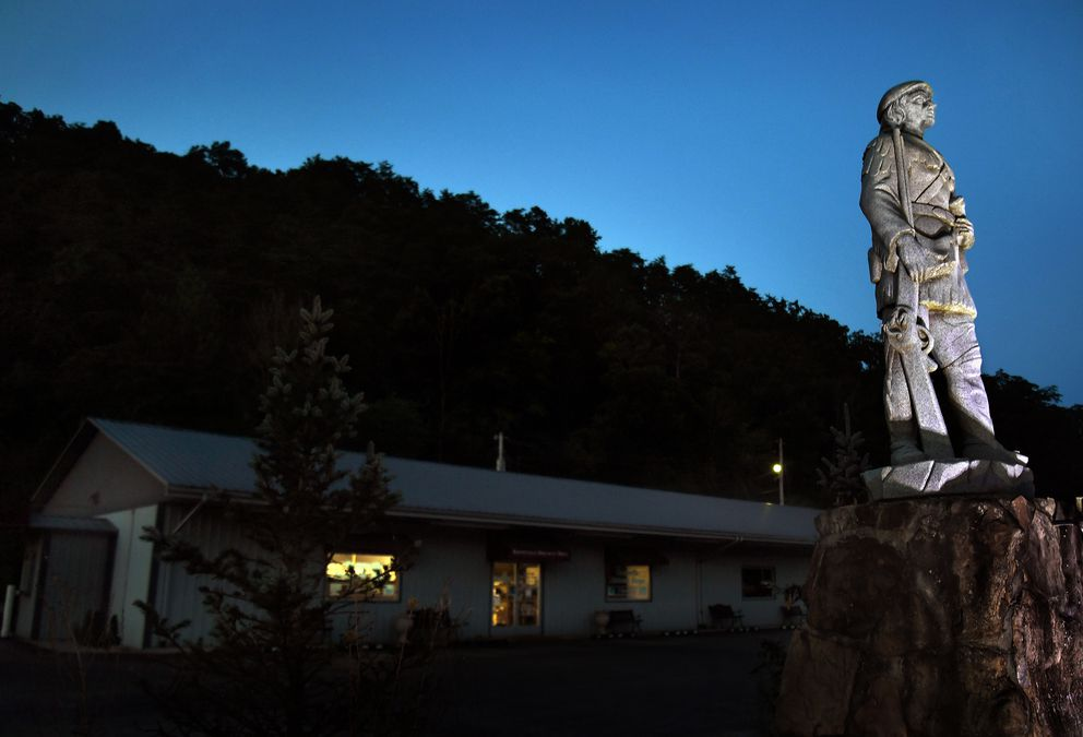 Booneville Discount Drugs in Kentucky features a statue of Daniel Boone above its burgundy sign. (Washington Post photo by Michael S. Williamson)