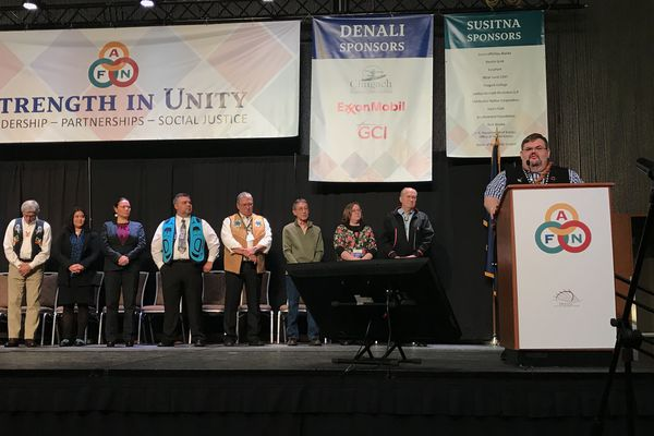 Richard Peterson, president of Tlingit and Haida Central Council, a regional tribal organization, addresses the Alaska Federation of Natives convention Friday in his role as chairman of the Governor's Tribal Advisory Council. Other members are on stage along with Lt. Gov. Byron Mallott and Gov. Bill Walker on Friday, Oct. 20, 2017, at the Alaska Federation of Natives convention at the Dena'ina Center in Anchorage. (Lisa Demer / Alaska Dispatch News)