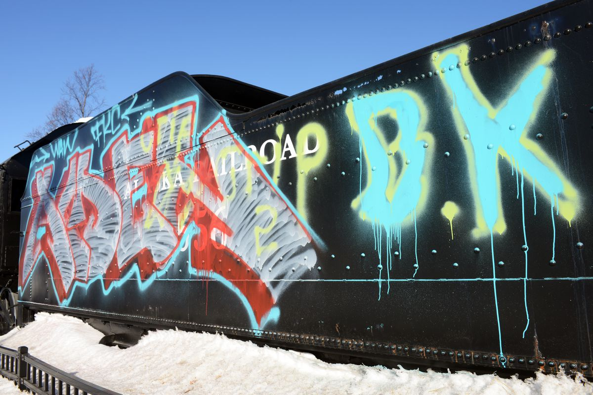 Vandalism mars the Engine 556 tender on Wednesday, March 22, 2017, at West Ninth Avenue and E Street on the Delaney Park Strip. (Erik Hill / Alaska Dispatch News)