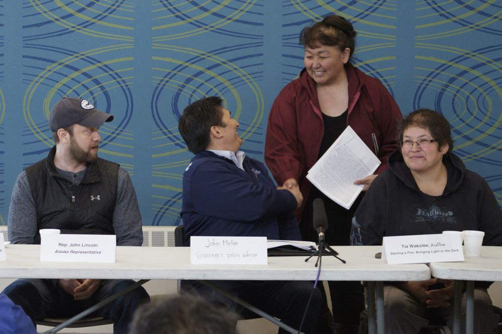 Lucy Henson greets panelists at the Thursday, June 6, 2019 meeting in Kotzebue. From left, Shady Grove Oliver, event moderator, Rep. John Lincoln, John Moller, policy advisor to Gov. Michael Dunleavy, Lucy Nelson, mayor of the Northwest Arctic Borough, and Tia Wakolee, author. (Nadia Sussman / ProPublica)