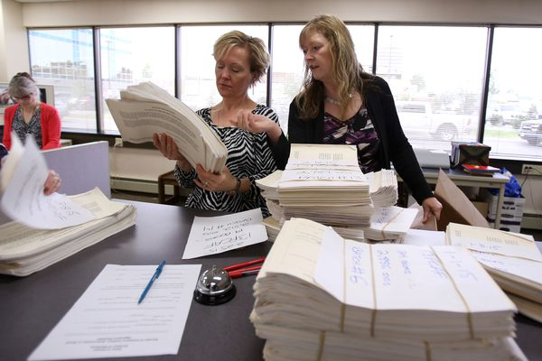 Katrin Haugh and Carol Thompson count the signatures taken to the office byThe Alaska Fisheries Conservation Alliance. 43,000 signatures were delivered to an Alaska Division of Elections office in Anchorage on Wednesday June 10, 2015. The signatures support a proposed ballot initiative that would decided whether or not to ban set net fishing in urban, non-subsistence areas of Alaska.