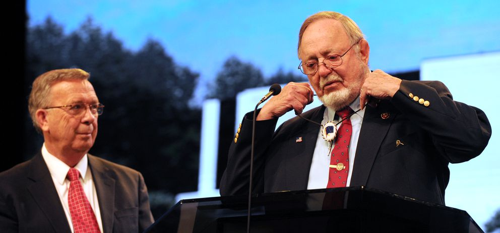 Rep. Don Young, right, removes a beaded bolo tie that his late wife Lu Young made for him and then gave it to Rev. Jerry Prevo who retired as pastor of Anchorage Baptist Temple on Sunday, May 5, 2019. (Bill Roth / ADN)