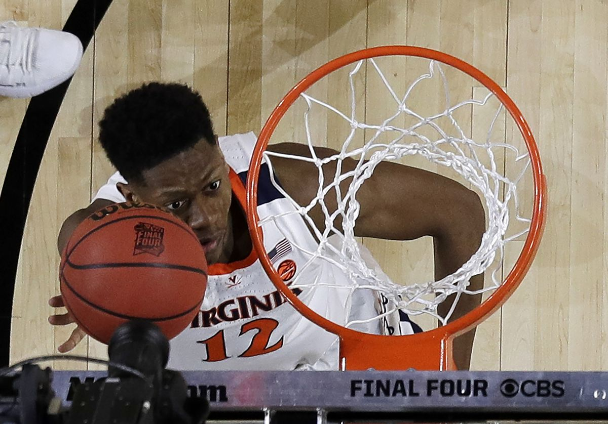 Virginia's De'Andre Hunter (12) goes up for a basket during the first half in the championship of the Final Four NCAA college basketball tournament against Texas Tech, Monday, April 8, 2019, in Minneapolis. (AP Photo/Jeff Roberson)