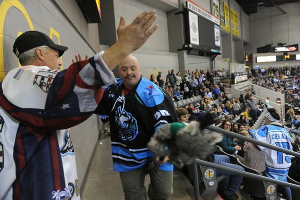 Alaska Aces super fan Bobby Hill rides again during an Alaska Aces alumni hockey game in front of a sold out crowd at the Sullivan Arena in Anchorage, AK on Friday November 8, 2019. (Bob Hallinen photo)