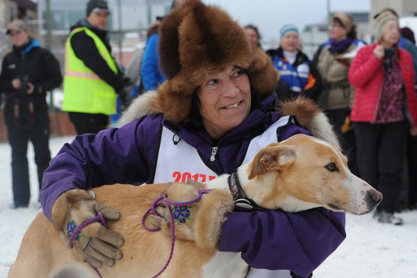 Roxy Wright with lead dog Cloud after winning her 4th Fur Rendezvous Open World Championship sled dog race on Sunday, Feb. 26, 2017, after taking more than two decades off from competing. (Bill Roth / Alaska Dispatch News)