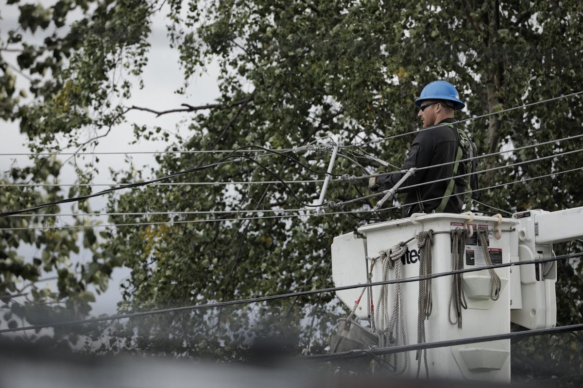 A crew from ML&P repairs wind-damaged power lines Wednesday in Mountain View. (Loren Holmes / Alaska Dispatch News)