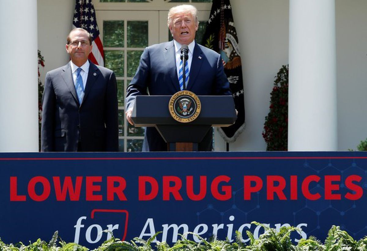 Health and Human Services Secretary Alex Azar listens Friday as President Donald Trump delivers a speech about lowering prescription drug prices from the Rose Garden at the White House. REUTERS/Jonathan Ernst