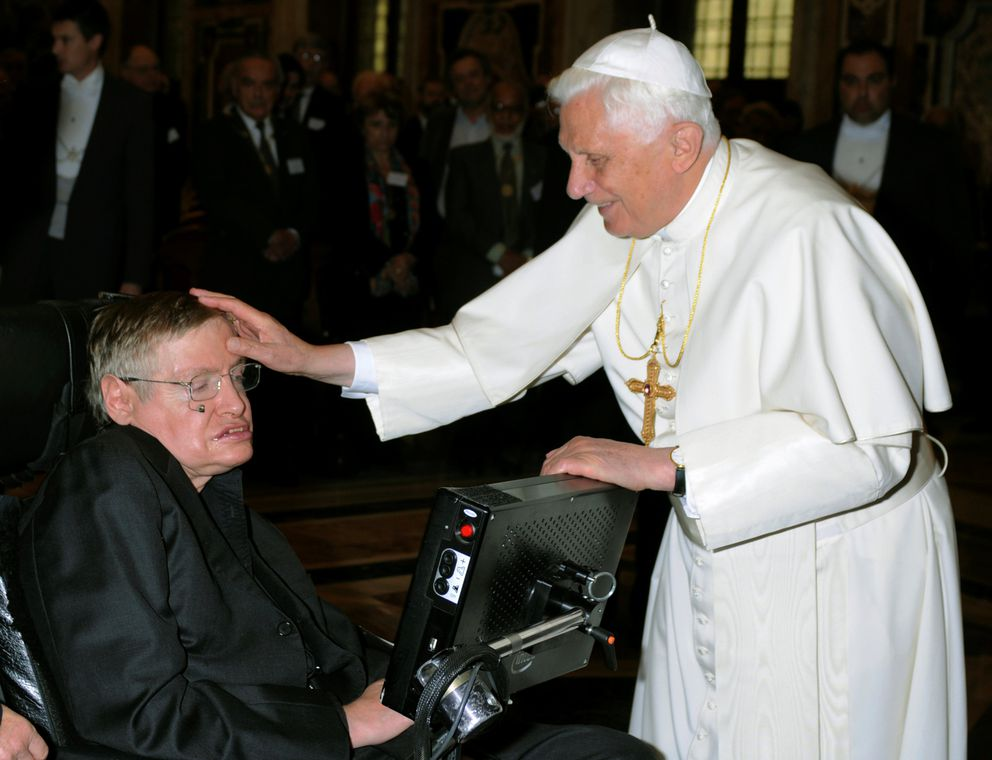 Pope Benedict XVI (R) greets British professor Stephen Hawking during a meeting of science academics at the Vatican October 31, 2008. REUTERS/Osservatore Romano/File Photo