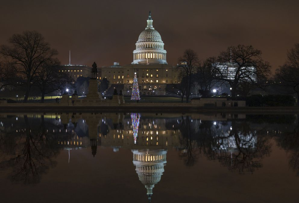 The Capitol is mirrored in the Reflecting Pool in Washington, Dec. 28, 2018. (AP Photo/J. Scott Applewhite)