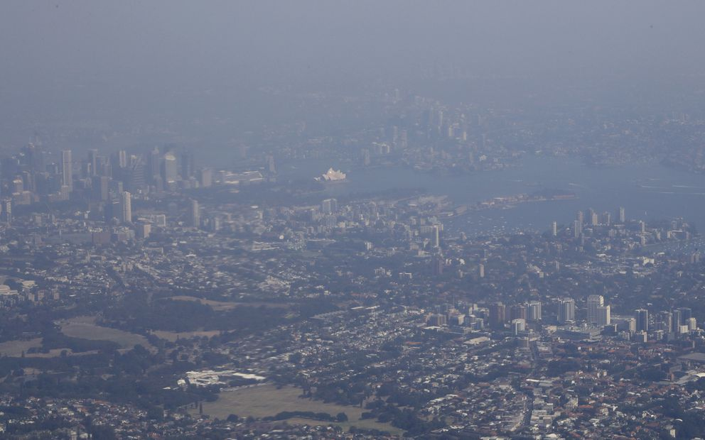 Bushfire smoke shrouds the skyline of Australia's largest city Sydney, Saturday, Jan. 4, 2020. Australia braced for one of the worst days in its wildfire crisis, with strong winds and high temperatures forecast to bring flames to more populated areas, including the suburbs of Sydney. (AP Photo/Mark Baker)