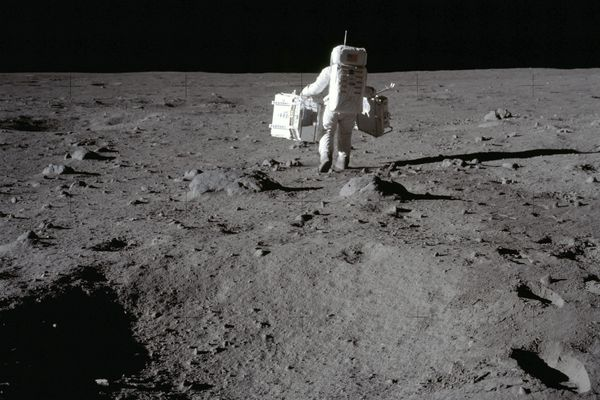 In this July 20, 1969 photo made available by NASA, lunar module pilot Buzz Aldrin carries a seismic experiments package in his left hand and the Laser Ranging Retroreflector to the deployment area on the surface of the moon at Tranquility Base. On Tuesday, Oct. 13, 2020, NASA released a set of guidelines for its Artemis moon-landing program, based on the 1967 Outer Space Treaty and other agreements - No fighting and littering. And no trespassing at historic lunar landmarks like Apollo 11′s Tranquility Base. (Neil Armstrong/NASA via AP)