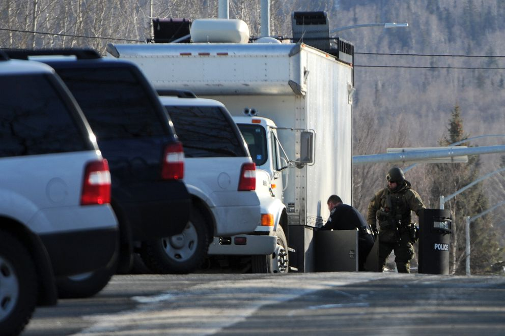 Anchorage police work a standoff on Old Muldoon Road. (Erik Hill / Alaska Dispatch News)