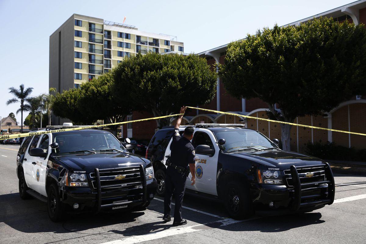 Long Beach police keep a street closed off at a crime scene. (AP Photo/Jae C. Hong/File)