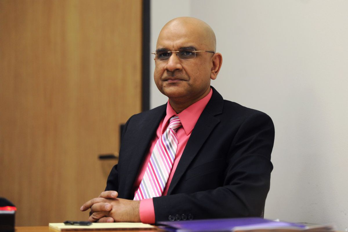 Dr. Mahmood Ahmad awaits the start of his appeals hearing on Thursday morning, May 26, 2016, in the Atwood Building downtown. (Erik Hill / Alaska Dispatch News)