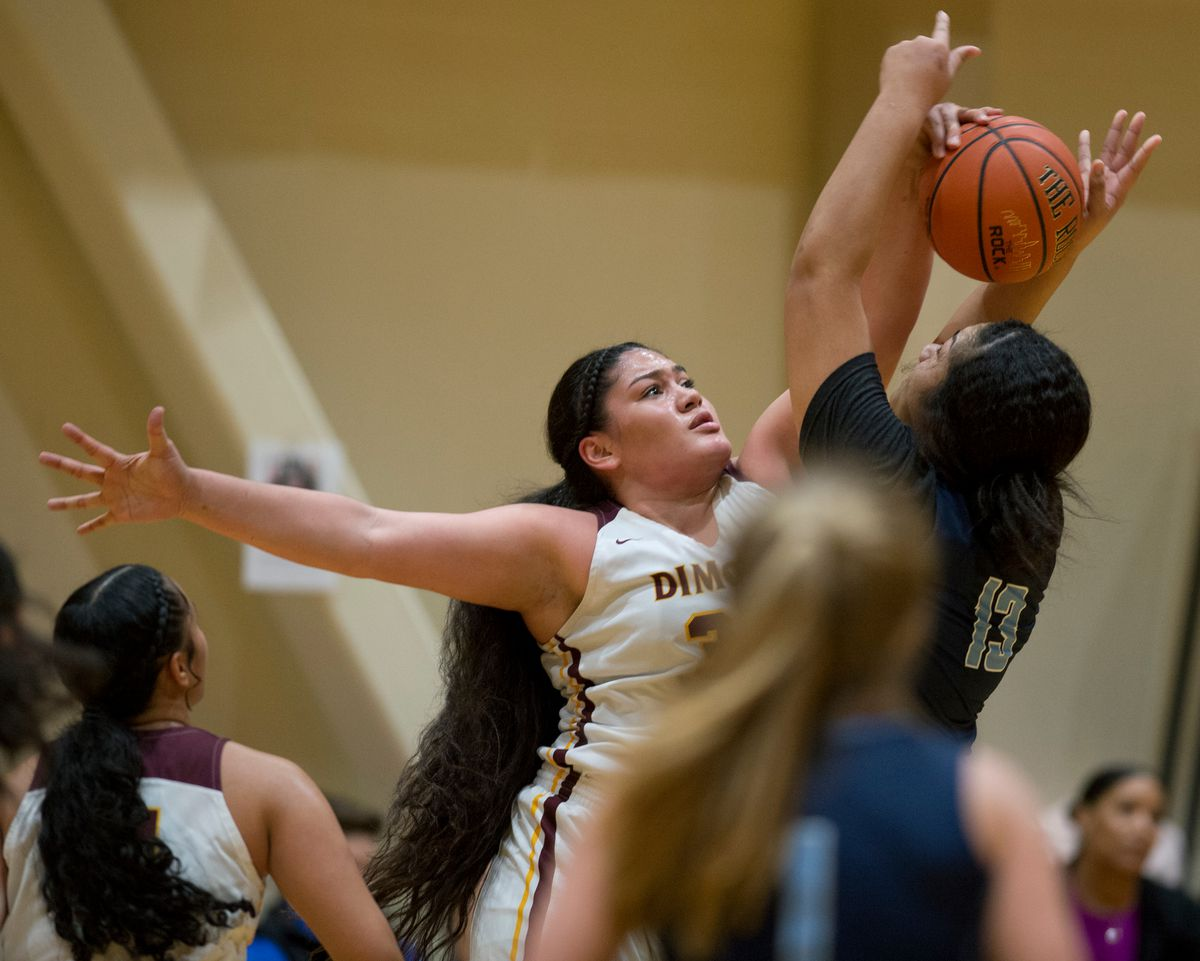 Dimond's Alissa Pili reaches to block a shot by Soldotna's Ituau Tuisaula on February 7, 2019. (Marc Lester / ADN)