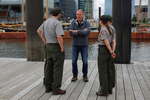 Interior Secretary Ryan Zinke, center, talks to National Park Service Rangers while traveling for his National Monuments Review process, in Boston, Massachusetts, June 16, 2017. (Brian Snyder / Reuters file)