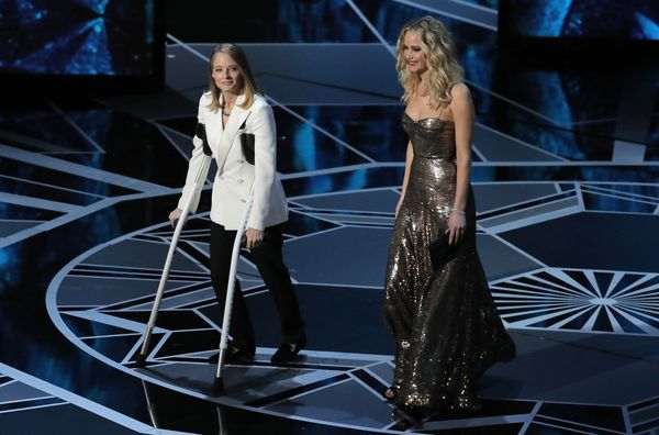 Jodie Foster and Jennifer Lawrence present the Best Actress Oscar. REUTERS/Lucas Jackson
