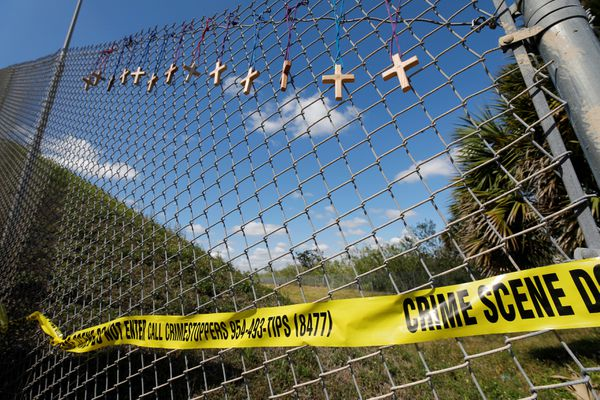 Crosses for the victims of yesterday's shooting at Marjory Stoneman Douglas High School hang on a fence a short distance from the school in Parkland, Florida, U.S., February 15, 2018. REUTERS/Jonathan Drake