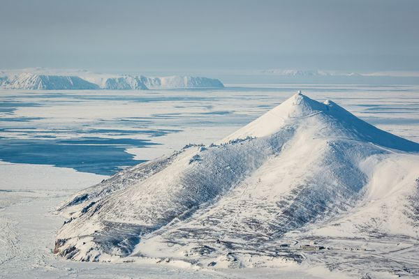 Little Diomede Island, in the Bering Strait, is visible from the edge of the Seward Peninsula. Chukotka, Russia is also visible in the background. (Loren Holmes / ADN archive 2013)