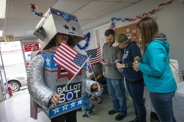 Kengo Nagaoka, dressed as the Ballot Bot, visits the Alaska Democratic Party coordinated campaign office Tuesday night, Aug. 21. The Alaska Center is sending their ballot bot to ask voters why they are voting. (Loren Holmes / ADN)