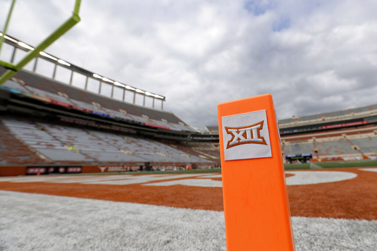 A Big 12 pylon marks the end zone at Darrell K Royal Texas Memorial Stadium before an NCAA college football game between Texas and Kansas State in Austin, Texas. Big 12 schools have agreed to play one nonconference football game this year to go along with their nine league contests as plans for the pandemic-altered season continued to fall into place. (AP Photo/Eric Gay, File)