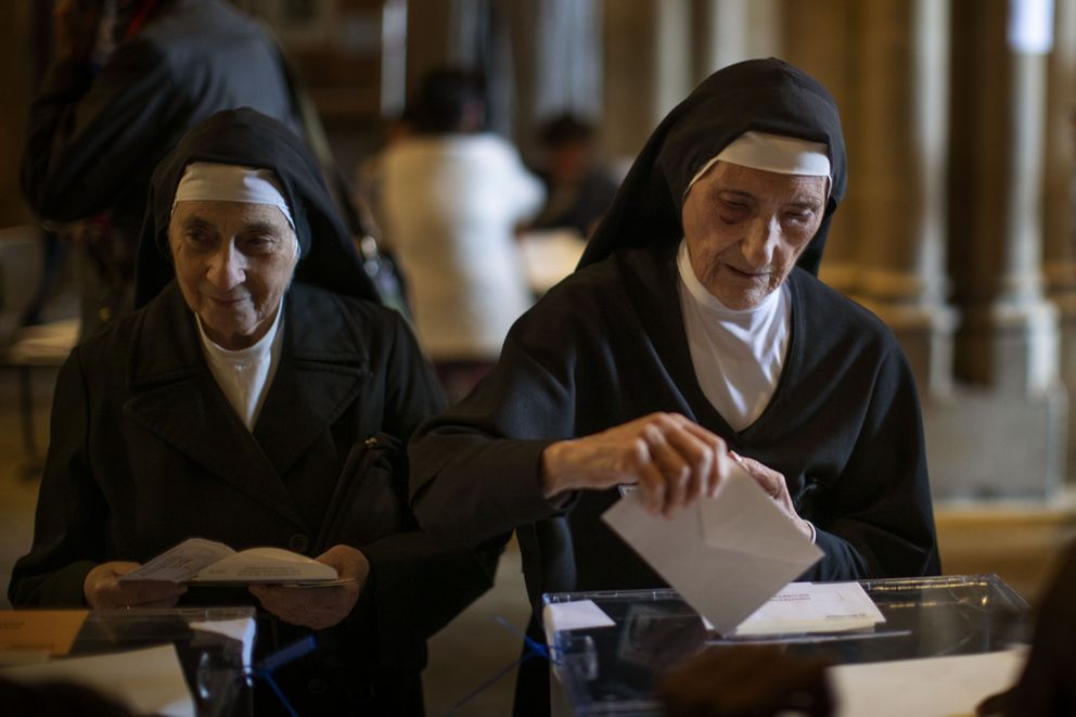 Nuns cast their ballot papers for the general election in Barcelona, Spain, Sunday, Nov.10, 2019. Spain holds its second national election this year after Socialist leader Pedro Sanchez failed to win support for his government in a fractured Parliament. (AP Photo/Emilio Morenatti)