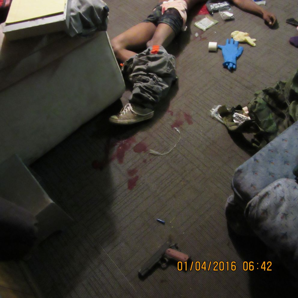 In a handout image, Eric John Senegal lies dead in his trailer after being killed during a no-knock police raid on his trailer in Ragley, La. Because fewer than a third of tactical teams use body cameras, the police version of events like the killing of Eric John Senegal is often the only one; a family lawyer suggests that the gun could have been planted. (Beauregard Parish District Attorney via The New York Times)