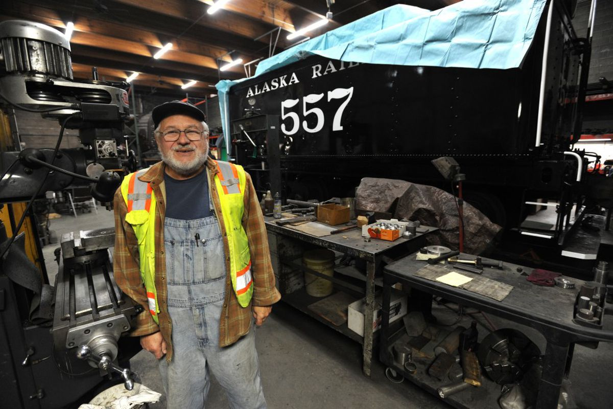 Engine 557 Restoration Company president Patrick Durand stands next to the nearly completed tender at the group's work site on Wednesday in Wasilla. (Erik Hill / Alaska Dispatch News)